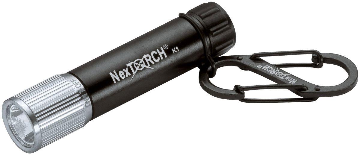 Фонарь-брелок Nextorch К1, цвет: черныйК1Фонарь-брелок Nextorch К1 светодиодный 40 люменФонарь - брелок K1. Данная модель относится к серии S. Это миниатюрные фонари, небольшого размера, их удобно всегда иметь под рукой, т. к. они могут легко крепиться как брелок. Фонарь - брелок K1 это самый маленький фонарь, который работает от одной батарейки ААА, имеет многофункциональный карабин. Поворотом блока головы фонарь можно легко включить и выключить. Режимы работы: Полная яркость 40 люм. Характеристики:Светодиод: CREE Q4 LED. Мощность, люмены: 40. Время работы, минуты: 100 (на максимальной яркости). Тип батареи: 1х ААA. Дистанция: 40 м. Материал корпуса: Авиационный алюминий 6061-T6 с анодированным покрытием. Водонепроницаемость: 1м. Ударопрочность: 1м. Диаметр головы: 14, 3 ммДиаметр корпуса: 13, 4 ммОбщая длинна: 63 ммВес с упаковкой: 62 гКомплектация: Фонарь, батарейка ААА, карабин. Компания Nextorch уделяет особенное внимание производству инновационных переносных осветительных приборов. Применение самых передовых технологий освещения позволяет использовать максимально яркие источники света, достигая при этом невероятной эффективности и исключительной долговечности элементов питания. Использование материалов аэрокосмических технологий - алюминия марки 6061-T6 с жестким анодированным покрытием Mil-Spec III для корпуса и элементов управления, придает фонарям Nextorch прочность, легкость, долговечность и эргономичность.