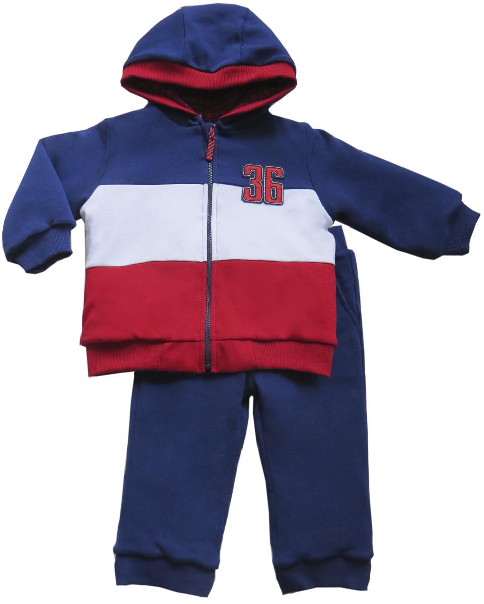 Комплект для мальчика Soni Kids Спортивная Академия: толстовка, брюки, цвет: синий, красный. З6121005. Размер 98З6121005Утепленный комплект для мальчика от Soni Kids, состоящий из толстовки и брюк, выполнен из плотного хлопкового материала. В качестве утеплителя используется синтепон. Толстовка с капюшоном и длинными рукавами спереди имеет застежку на молнию. Нижний край изделия и манжеты рукавов отделаны широкой трикотажной резинкой. На груди толстовка оформлена нашивкой. Брюки прямого кроя с широкой резинкой на талии дополнены боковыми карманами и трикотажными манжетами по низу брючин. В таком комплекте вашему непоседе будет тепло и уютно.
