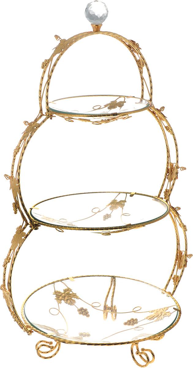 Конфетница Loraine Ванеса, 3-ярусная, 38,5 х 29,5 х 63 см. 2666241016/Элегантная конфетница Loraine, выполненная из стекла, сочетает в себе изысканный дизайн с максимальной функциональностью. Конфетница состоит из 3-х ярусов разного размера и предназначена для красивой сервировки конфет, фруктов и десертов. Ярусы конфетницы оформлены оригинальным золотым орнаментом. Стойка-держатель конфетницы выполнена из стали с золотым покрытием. Конфетница украсит сервировку вашего стола и подчеркнет прекрасный вкус хозяина, а также станет отличным подарком.