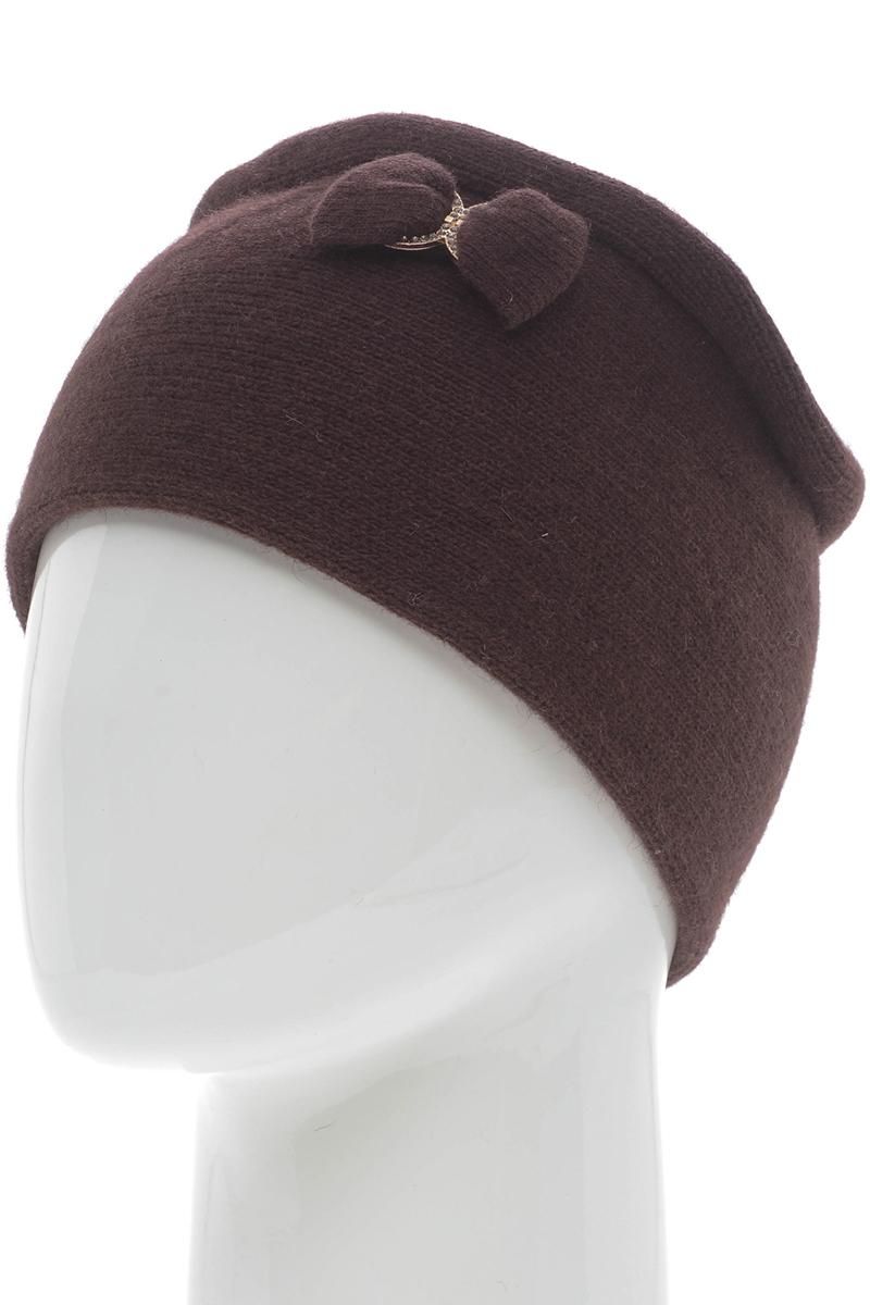 Шапка женская Vita Pelle, цвет: коричневый. NSH61892L-85. Размер 58/60NSH61892L-85Женская шапка от бренда Vita Pelle выполнена из качественного смесового материала. Модель без подкладки дополнена оригинальной прошитой складкой и декоративным бантиком.