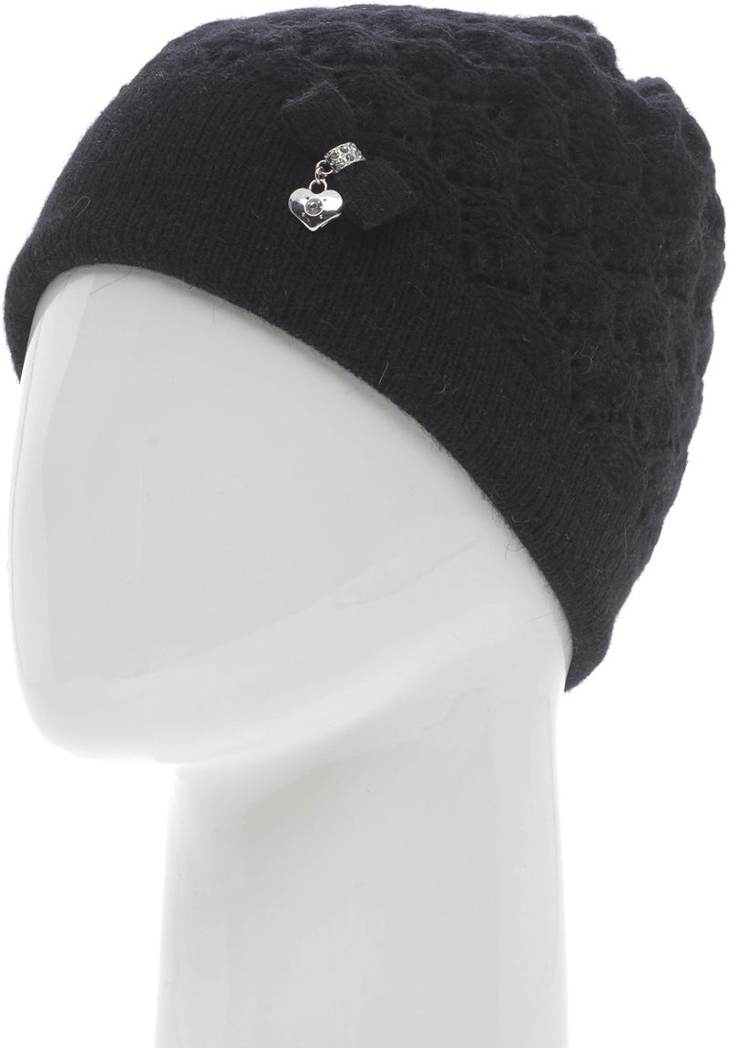 Шапка женская Vita Pelle, цвет: черный. NSH61873L-18. Размер 58/60NSH61873L-18Женская шапка от бренда Vita Pelle выполнена из качественного смесового материала. Вязаная модель дополнена декоративным бантиком с сердечком.