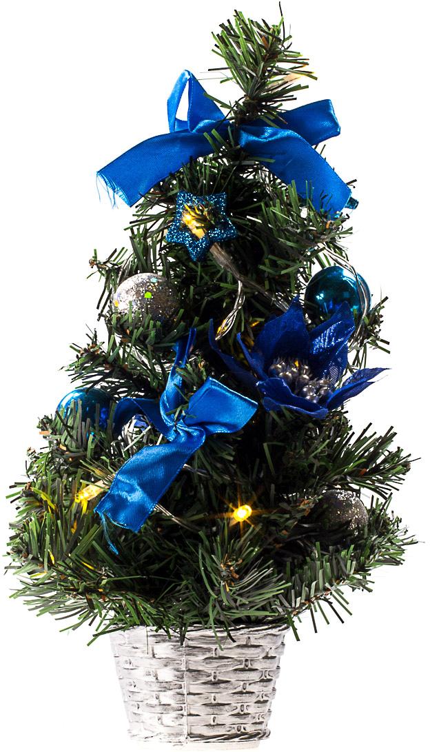 Милая наряженная елочка в корзинке украшена игрушками, мишурой и гирляндой. Она будет уместна и дома, и в офисе. Весело подмигивая всеми своими огоньками, она преобразит пространство, подарив праздник и новогоднее настроение.