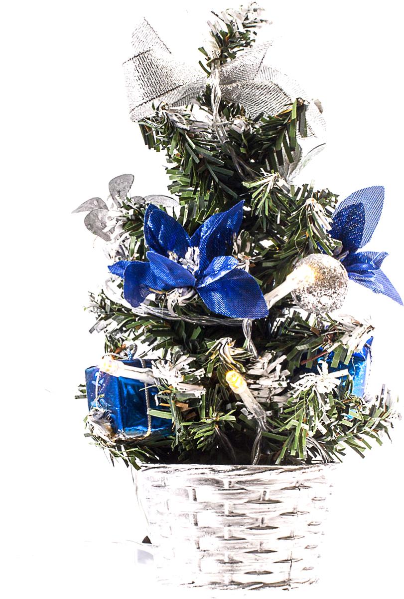 Елка настольная c игрушками и гирляндой Vita Pelle, 20 см. K11EL3001K11EL3001Милая наряженная елочка в корзинке украшена игрушками, мишурой и гирляндой. Она будет уместна и дома, и в офисе. Весело подмигивая всеми своими огоньками, она преобразит пространство, подарив праздник и новогоднее настроение.