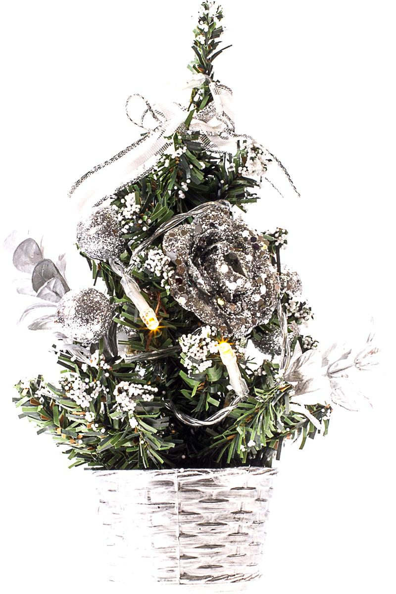 Елка настольная c игрушками и гирляндой Vita Pelle, 20 см. K11EL3011K11EL3011Милая наряженная елочка в корзинке украшена игрушками, мишурой и гирляндой. Она будет уместна и дома, и в офисе. Весело подмигивая всеми своими огоньками, она преобразит пространство, подарив праздник и новогоднее настроение.