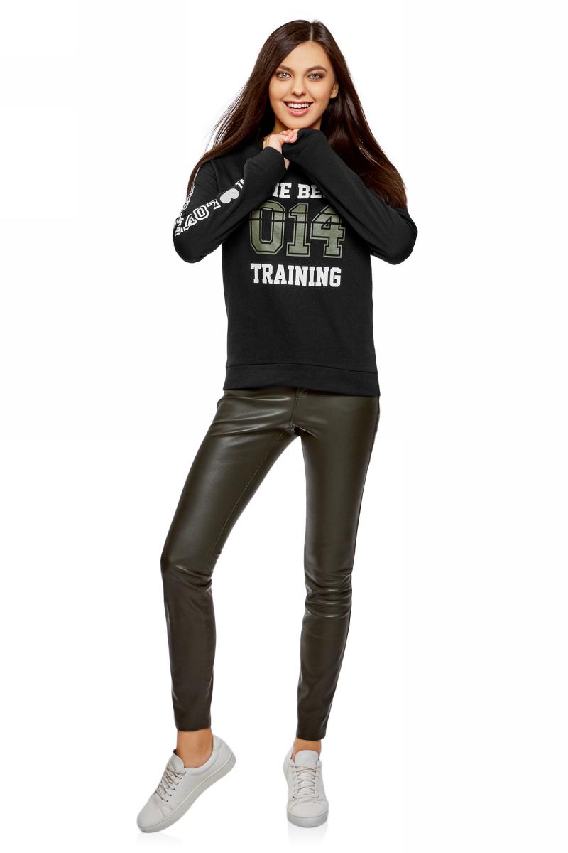 Свитшот женский oodji Ultra, цвет: черный. 14808015-23/46151/2919P. Размер XL (50)14808015-23/46151/2919PСвитшот от oodji выполнен из натурального хлопкового трикотажа. Модель свободного кроя с длинными рукавами и круглым вырезом горловины спереди и на рукаве оформлен надписями. Манжеты рукавов и низ изделия дополнены трикотажными резинками.