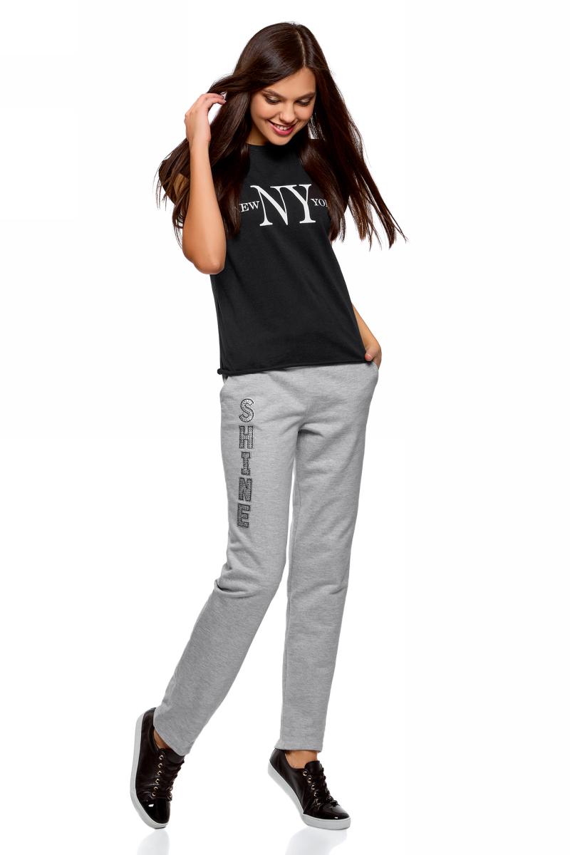 Брюки спортивные женские oodji Ultra, цвет: серый. 16701053-1/47906/2391Z. Размер S (44)16701053-1/47906/2391ZЖенские брюки, выполненные из натурального хлопка, подойдут как для повседневной носки, так и для занятий спортом. Модель на талии имеет широкую эластичную резинку со шнурком-кулиской. Спереди брюки оснащены двумя втачными карманами, сзади одним накладным карманом.