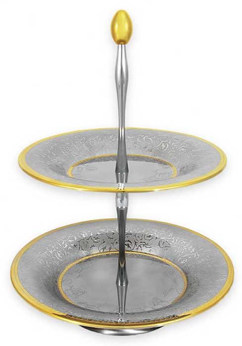 Ваза для фруктов Giorinox Dubai Gold/Silver, двухъярусная, 40 см. GI1263-00/PALGI1263-00/PALВаза для фруктов (двухъярусная) 40 см. Dubai Gold/SilverВсе изделия фирмы Giorinox произведены из нержавеющей пищевой стали марки 18/10; отполированные до зеркального блеска и декорированные золотом 24 карата, они являются достойным и изысканным украшением стола. Все изделия можно мыть в теплой воде с применением мягких моющих средств. Не допускается применение абразивных порошков и паст. Фарфоровые формы с декоративной золотой отделкой нельзя использовать в микроволновой печи, они предназначены для сервировки стола или приготовления пищи в духовых шкафах. В случае использования фарфоровой жаропрочной формы в качестве формы для запекания в духовом шкафу, необходимо срезать синтетические кружки с наружного дна формы, служащие для предохранения металлической формы от появления царапин.