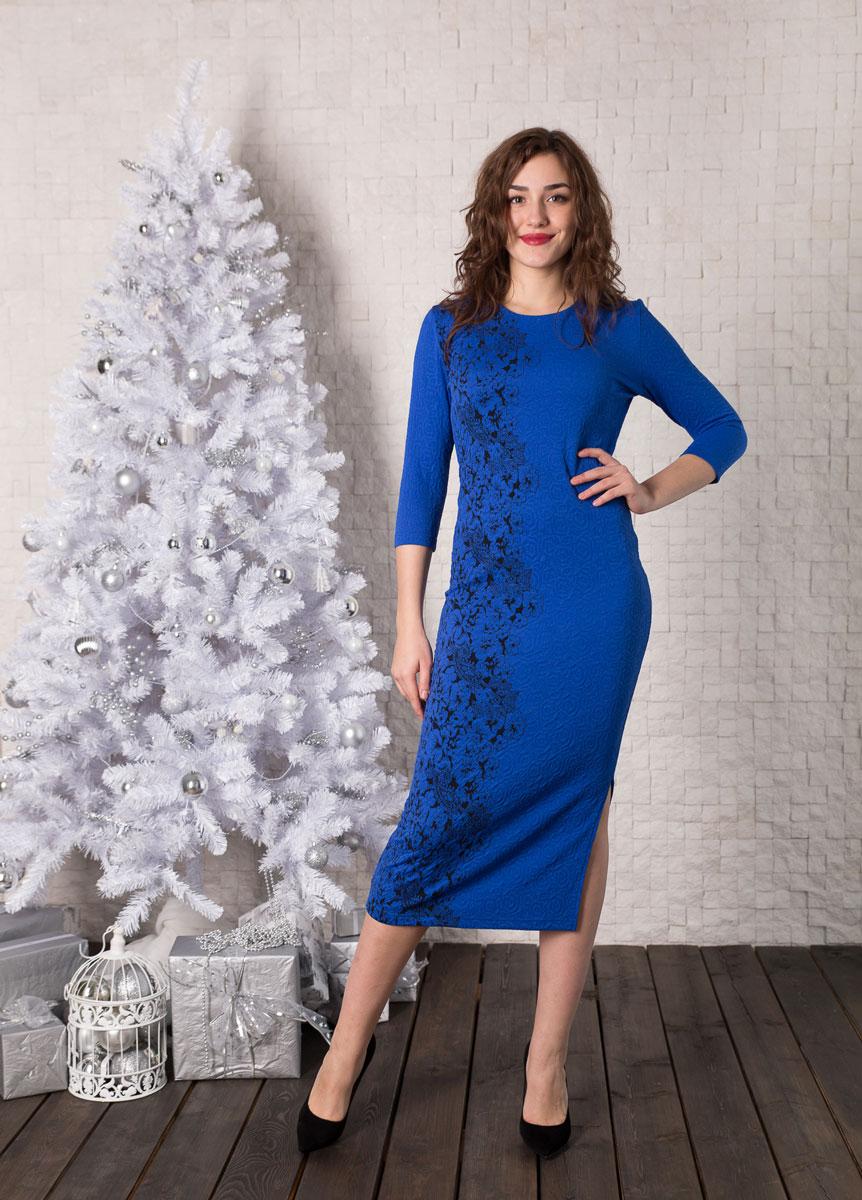 Платье Lautus, цвет: синий, черный. 930. Размер 44930Платье-миди от Lautus прилегающего силуэта, выполненное их трикотажа яркого цвета. Рукава длинные. Круглый вырез горловины. Платье дополнено изящным разрезом в боковом шве.