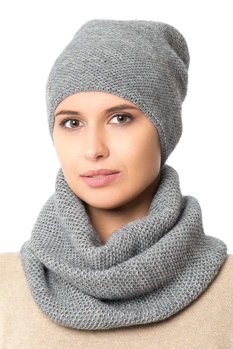 Шапка женская Nuages, цвет: серый. NH-721/010. Размер 52/56NH-721/010Женская вязаная шапка от Nuages выполнена из хлопково-акриловой пряжи. Такая шапка согреет вас в холодное время года и станет отличным дополнением к любому вашему образу.