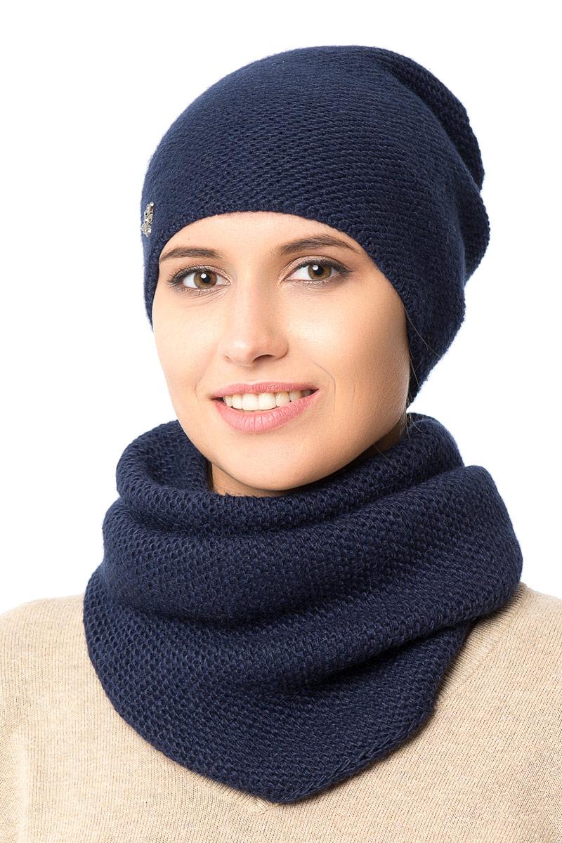 Шапка женская Nuages, цвет: темно-синий. NH-721/188. Размер 52/56NH-721/188Женская вязаная шапка от Nuages выполнена из хлопково-акриловой пряжи. Такая шапка согреет вас в холодное время года и станет отличным дополнением к любому вашему образу.