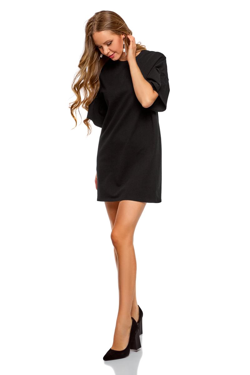 Платье oodji Ultra, цвет: черный. 14000172B/48033/2900N. Размер XS (42)14000172B/48033/2900NСтильное платье, выполненное из комбинированного материала, отлично дополнит ваш гардероб. Модель с короткими цельнокроеными рукавами и круглым вырезом горловины. Рукава декорированы воланами.