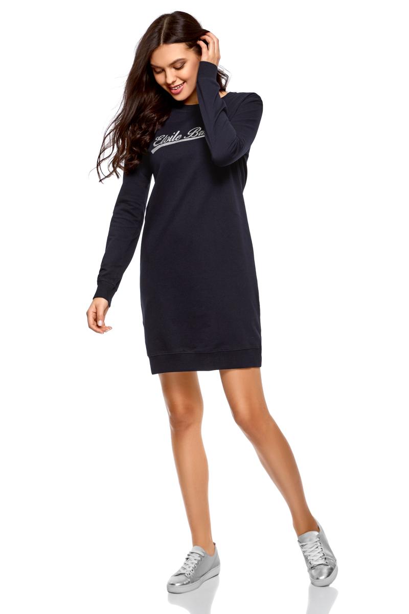 Платье oodji Ultra, цвет: темно-синий. 14001199-5/46919/7991P. Размер XXS (40)14001199-5/46919/7991PПлатье от oodji в спортивном стиле выполнено из натурального хлопкового трикотажа. Модель свободного кроя с круглым вырезом горловины и длинными рукавами на груди оформлена принтованной надписью.