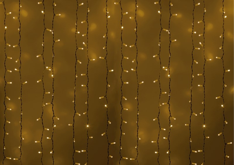 Гирлянда Neon-Night Светодиодный Дождь, постоянное свечение, цвет: белый, желтый, 2 х 3 м235-131Гирлянда Светодиодный Дождь представляет собой гибкий горизонтальный шнур-шину (2м), к которому через определенные промежутки крепятся вертикальные нити (20 шт.) со светодиодными лампами, которые отличаются от «Бахромы» тем, что имеют одинаковую, достаточно значительную длину, часто превышающую протяженность шины. На концах каждой шины есть разъем и штепсель, которые предназначены для последовательного соединения нескольких световых дождей в большой занавес ПЛЕЙ-ЛАЙТ. Используя занавес, можно не только создавать красивые световые занавесы или оформлять различные плоскости, например, фасады домов, окна и т.д., но и украшать объемные объекты. Гирлянду, работающую в непрерывном свечении, называют фиксинг, а использующую режим светодинамики – чейзинг. Светодинамические эффекты становятся доступными только при подключении гирлянды к сети через специальный контроллер.Сегодня в гирляндах источником света служат светодиоды, которые пришли на смену применявшимся ранее лампам накаливания. С полупроводниковыми источниками гирлянда стала более надежной, потребляет меньше энергии, обрела более насыщенное сияние. Данная гирлянда имеет желтый цвет свечения светодиодов.