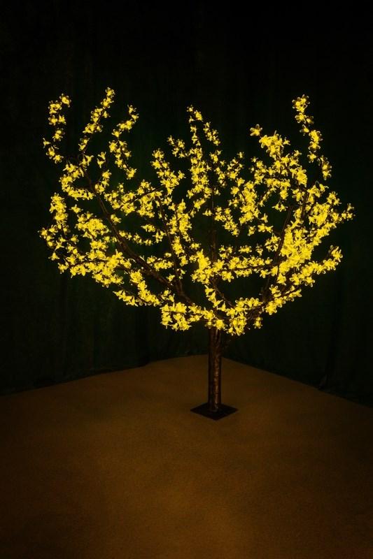 """Световое дерево """"Сакура"""" представляет собой имитацию цветущей японской сакуры. Оно используется для декоративного освещения интерьеров и ландшафтов. Такое дерево может стать прекрасным украшением для вашего дома, офиса, торгового зала, кафе, ресторана или загородного участка. Оно создаст уют, придаст оригинальный стиль и необходимый вам колорит независимо от времени года.   Конструкция имеет лекгосплавной каркас в оболочке из темного пластика. На ветках дерева расположены яркие светодиодные гирлянды с силиконовыми насадками (цветками). Светодиодное дерево выглядит очень натурально.  Питание осуществляется через сетевой трансформатор, поэтому изделие является низковольтным и может использоваться в уличных условиях.     Диаметр кроны: 1,8 м.     Высота дерева: 1,5 м.                 864 лепестка."""