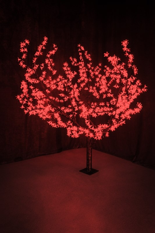 Светодиодное дерево Neon-Night Сакура, цвет: красный, диаметр кроны 180 см, высота 150 см531-102Световое дерево Сакура представляет собой имитацию цветущей японской сакуры. Оно используется для декоративного освещения интерьеров и ландшафтов. Такое дерево может стать прекрасным украшением для вашего дома, офиса, торгового зала, кафе, ресторана или загородного участка. Оно создаст уют, придаст оригинальный стиль и необходимый вам колорит независимо от времени года. Конструкция имеет лекгосплавной каркас в оболочке из темного пластика. На ветках дерева расположены яркие светодиодные гирлянды с силиконовыми насадками (цветками). Светодиодное дерево выглядит очень натурально.Питание осуществляется через сетевой трансформатор, поэтому изделие является низковольтным и может использоваться в уличных условиях. Диаметр кроны: 1,8 м. Высота дерева: 1,5 м. 864 лепестка.