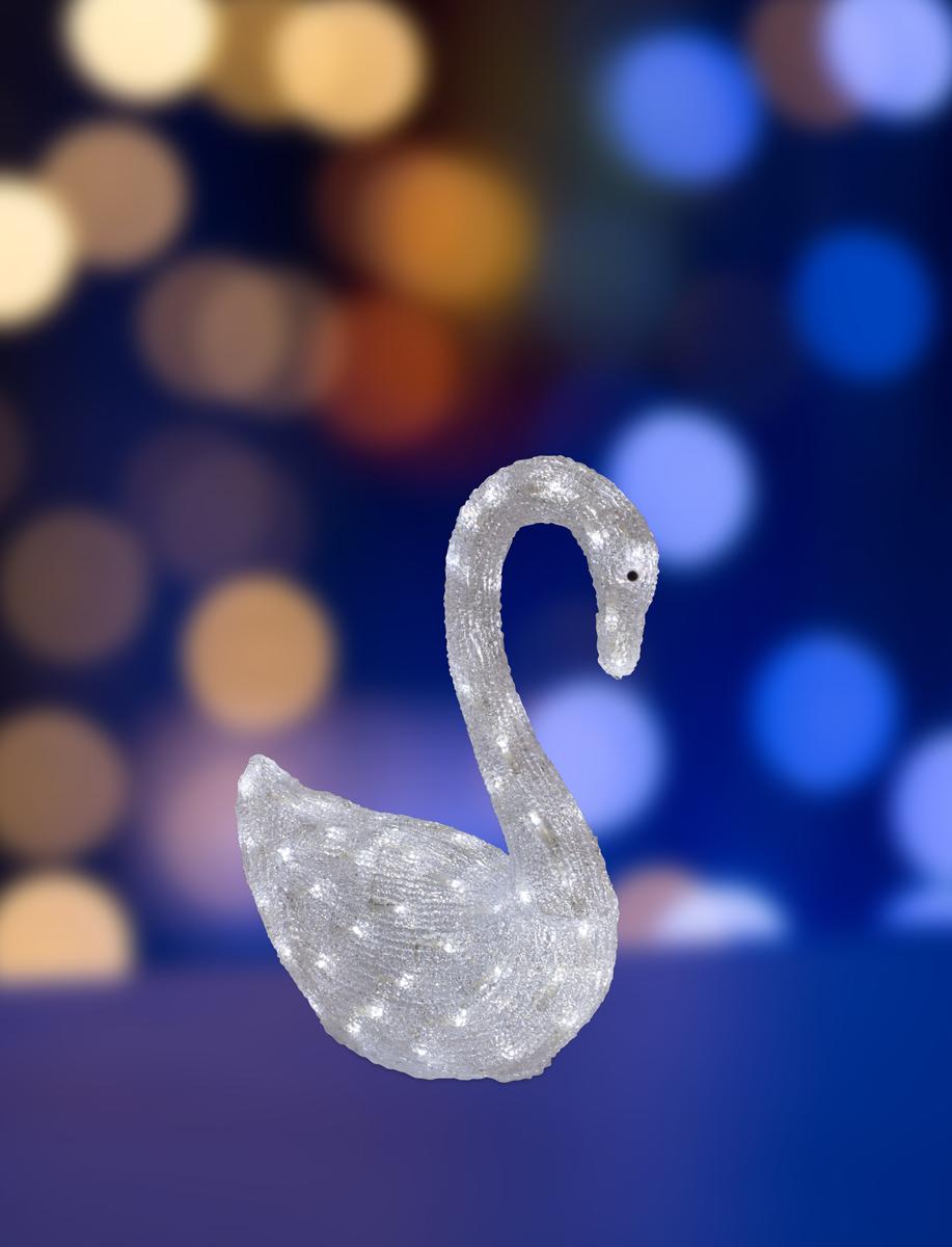 Фигура акриловая светодиодная Neon-Night Лебедь, 100 LED, с понижающим трансформатором, 36 х 18 х 50 см513-246Акриловые фигуры за несколько лет вызвали большой интерес у дизайнеров и частных клиентов. С каждым годом расширяется не только ассортимент акриловых фигур, но и появляются новые технологии нанесения акрила. Эти яркие, светящиеся объемные фигуры, состоящие из металлического каркаса, акрила и светодиодов, применяются для оформления и создания новогодней атмосферы в кафе, ресторанах, торговых центрах, магазинах, на площадях и перед входом, а также просто в частных домах и квартирах. Все фигуры укомплектованы понижающим трансформатором , что обеспечивает безопасность при контактировании, а так же имеют степень защиты IP 44, что позволяет использовать их как в помещении, так и на улице. Акриловая светодиодная фигура Лебедь высотой 36 см, светящаяся более чем 100 ярких диодов, выполнена по специальной технологии нанесения акрила. Она позволит Вам создать ту самую, настояющую новогоднюю атмосферу и принести сотни радостных улыбок.