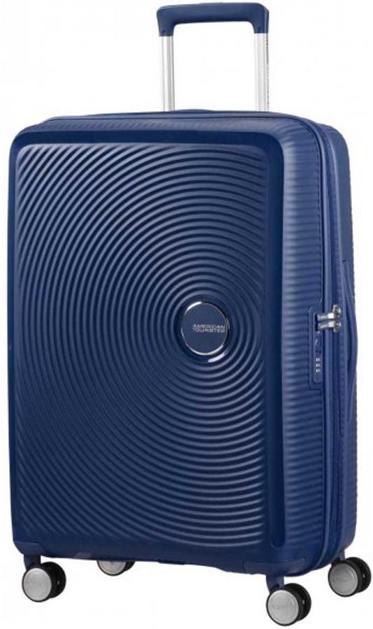 Чемодан American Tourister Soundbox, цвет: темно-синий, 71,5 л. 32G-4100232G-41002Чемодан с расширением American Tourister Soundbox прекрасно подойдет для путешествий. Изготовлен из прочного пластика с текстильной подкладкой.Чемодан очень вместителен. Благодаря дополнительной молнии увеличивается объем чемодана. Изделие содержит продуманную внутреннюю и внешнюю организацию, которая позволит аккуратно и рационально разместить ваши вещи.Имеется одно большое отделение, закрывающееся по периметру на застежку-молнию с двумя бегунками. Большое отделение для хранения одежды и дополнительное отделение на молнии оснащены перекрещивающимися багажными ремнями, которые соединяются при помощи пластикового карабина.Также внутри имеется втачной карман на застежке-молнии. Такая организация позволяет удобно разложить вещи и избежать их сминания.Для удобной перевозки чемодан оснащен четырьмя маневренными колесами, которые обеспечивают легкость перемещения в любом направлении. Телескопическая ручка выдвигается нажатием на кнопку и фиксируется нескольких положениях. Сверху и сбоку предусмотрены удобные ручки для поднятия чемодана.Чемодан оснащен кодовым замком TSA, который исключает возможность взлома. Отверстие в кодовом замке предназначено для работников таможни (открытие багажа для досмотра без присутствия хозяина). Ключ находится только у таможни. Чемодан American Tourister Soundbox идеально подходит для поездок и путешествий. Он вместит все необходимые вещи и станет незаменимым аксессуаром во время поездок.Как выбрать чемодан. Статья OZON Гид