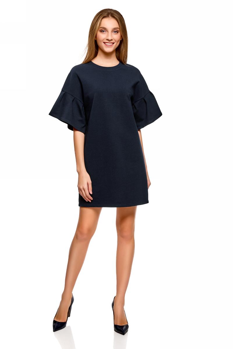 Платье oodji Ultra, цвет: темно-синий. 14000172B/48033/7900N. Размер XS (42)14000172B/48033/7900NСтильное платье, выполненное из комбинированного материала, отлично дополнит ваш гардероб. Модель с короткими цельнокроеными рукавами и круглым вырезом горловины. Рукава декорированы воланами.