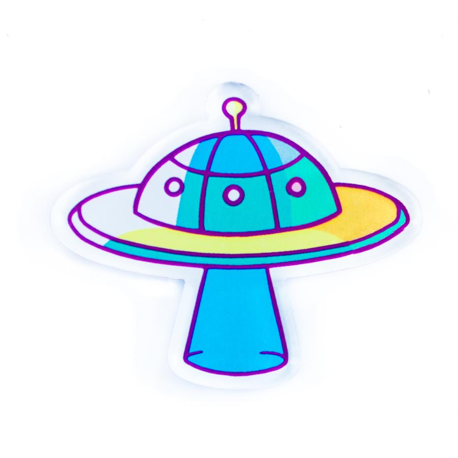 """Яркая и позитивная брошь """"НЛО"""" – неопознанный летающий объект и стильная деталь твоего внешнего вида, гармонично соединенные в одном предмете!Позитивный значок """"НЛО"""" в кислотных желто-бирюзовых тонах наполнит свежим настроением любой гардероб. Значок легко крепится с одной вещи на другую, что позволяет тебе ежедневно менять луки, и при этом все равно оставаться самым стильным и неопознанно-летающим!"""