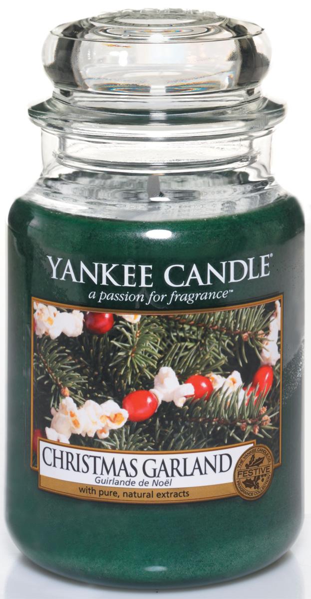 Свеча ароматизированная Yankee Candle Christmas garland, высота 16,8 см1316480EНастоящий еловый аромат в вашем доме. Верхняя нота: Зелень. Средняя нота: Хвоя. Базовая нота: Древесные Ноты.