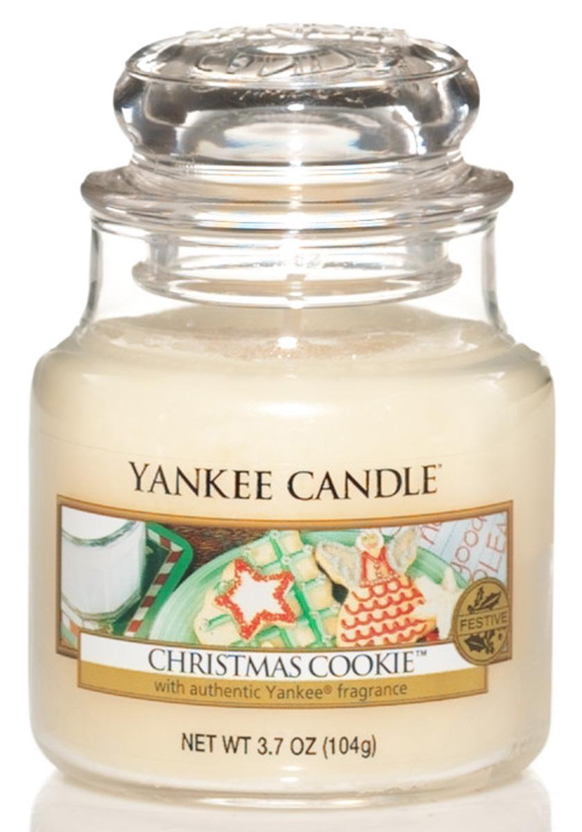 Свеча ароматизированная Yankee Candle Christmas сookie, высота 8,6 см138504EБогатый и маслянистый аромат душистой ванили это праздничное сахарное печенье. Верхняя нота: Сливочная ВанильСредняя нота: Мускатный Орех, Корица, СахарБазовая нота: Ваниль, Масло, Печенье