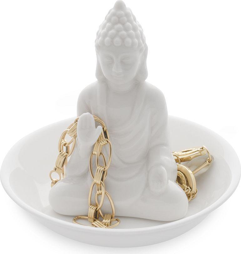 Подставка для украшений Balvi Buddha26438Хранение своих украшений и бижутерии для каждой девушки становится настоящей проблемой. Решить её можно простым и оригинальным способом. Испанская компания Balvi предлагает подставку для украшений Buddha. Она выполнена из белоснежной керамики и представляет собой небольшую фигурку Будды в чашеобразной подставке. На неё можно складывать различные аксессуары и драгоценные украшения. Подставка отличается детальностью проработки и собственным стилем.• Особый оригинальный стиль • Удобная и практичная подставка для хранения различных аксессуаров • Высокое качество исполнения и проработки каждой детали • Прочность и долговечность изделия