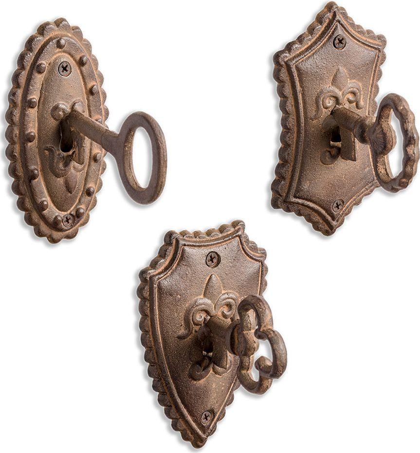 Вешалка настенная Balvi Castle, 3 шт26442Если вы не хотите загромождать прихожую большим напольным шкафом для одежды, вампригодится настенная вешалка Castle. В комплект входит 3 штуки, чего вполне достаточно длясемьи. Вешалки выполнены в виде замочной скважины со вставленным ключом, благодаря чемуони гармонично дополнят интерьер коридора. Каждая вешалка крепится с помощью 2 саморезов,так что они легко выдержат тяжелую зимнюю одежду. Крючки сделаны в форме ключиков,поэтому можно повесить вешалки пониже, и на них удобно будет вешать сумки. • В комплекте 3 вешалки и 6 саморезов с дюбелями • Легко крепятся на стену • Выполнены из металла, поэтому могут выдержать даже теплые зимние вещи