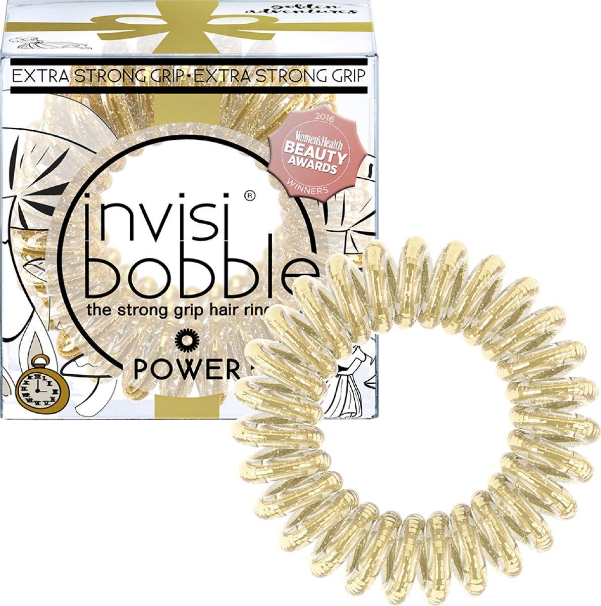 Invisibobble Резинка-браслет для волос Power Golden Adventure, 3 шт3110Резинки-браслеты Invisibobble Power Golden Adventures сияющего золотого цвета из лимитированной тематической коллекции Invisibobble I Live in Wonderland. Эксклюзивная упаковка с тематическим рисунком подарит настроение волшебных приключений!Коллекция Invisibobble Power создана для всех, кто ведёт активный образ жизни! Резинки-браслеты Invisibobble Power немного больше в размере, чем Invisibobble Original, а также имеют более плотные витки. Это позволяет плотно фиксировать волосы во время занятий спортом и активного отдыха. Invisibobble Power также идеальны для густых волос. Резинки подходят для всех типов волос, надежно фиксируют причёску, не оставляют заломы и не вызывают головную боль благодаря неравномерному распределению давления на волосы. Кроме того, они не намокают и не вызывают аллергию при контакте с кожей, поскольку изготовлены из искусственной смолы.