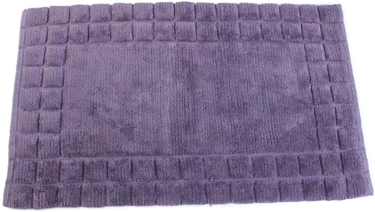 Коврик махровый фиолетового цвета изготовлен из 100% хлопка. Может использоваться в качестве прикроватного коврика или коврика для ванной комнаты.