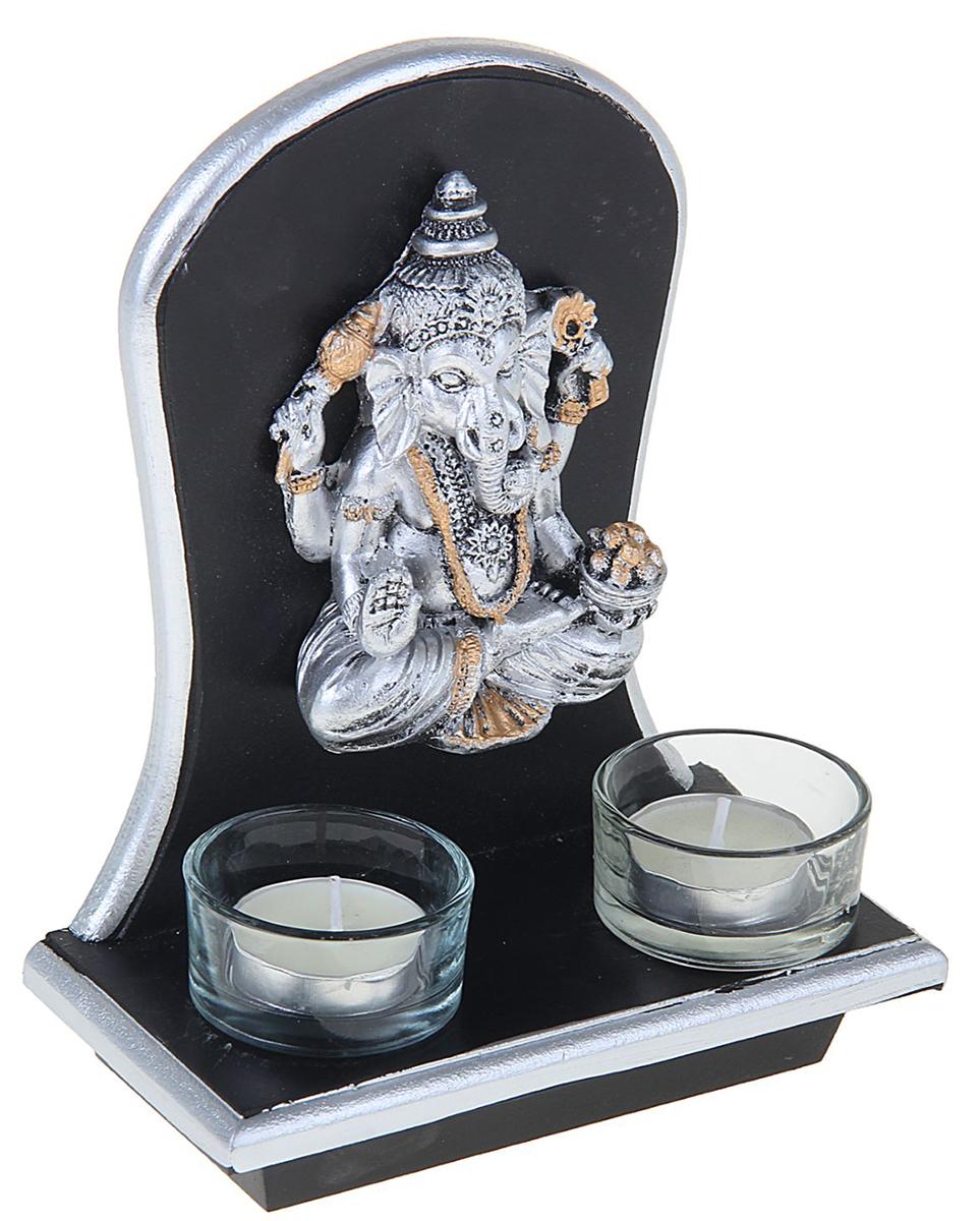 Подсвечник Ганеша, на 2 свечи, цвет: темно-коричневый, серый, 17 х 8,5 х 15 см1261873Перед вами подсвечник, который отлично впишется в интерьер в колониальном или восточном стиле. В него помещается 1 чайная свеча.