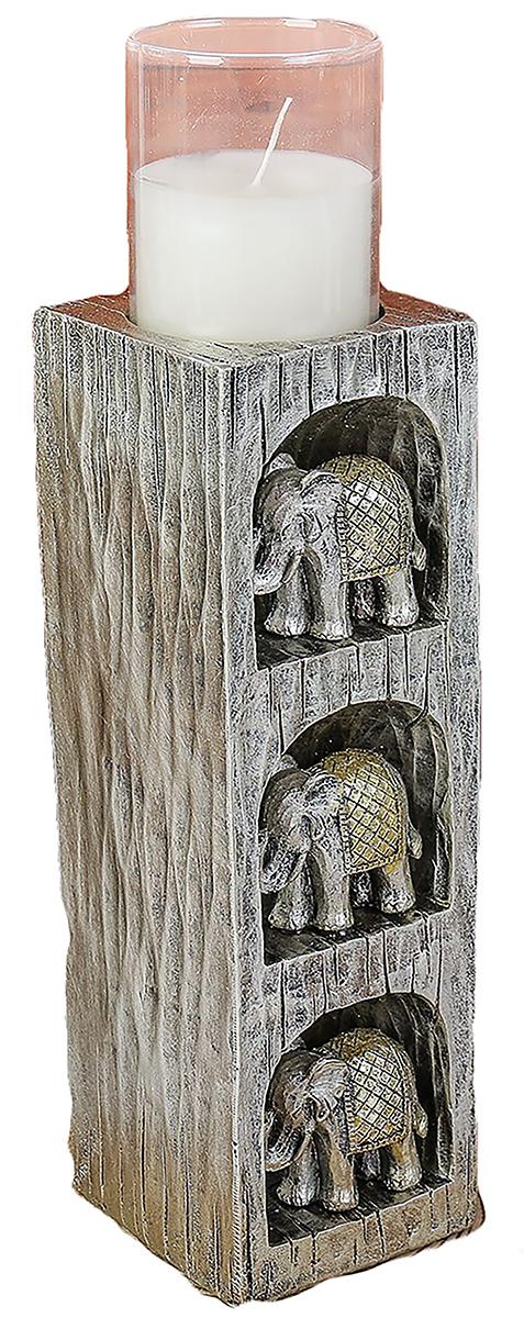 Подсвечник 3 слона, цвет: серый, 7 х 7 х 28,5 см1964900Невозможно представить нашу жизнь без праздников! Мы всегда ждем их и предвкушаем, обдумываем, как проведем памятный день, тщательно выбираем подарки и аксессуары, ведь именно они создают и поддерживают торжественный настрой. — это отличный выбор, который привнесет атмосферу праздника в ваш дом!Известно, что на пламя можно смотреть вечно: его мягкое золотистое сияние проясняет сознание и чарует. Огонь свечи притягивает наше внимание еще больше. Он делает атмосферу загадочной и романтичной.