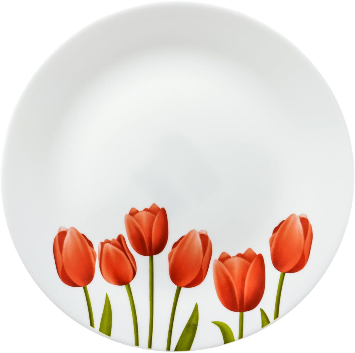 Тарелка La Opala Тюльпаны, диаметр 26,7 смOPTG001В 18 веке купец и гончар из Бристоля изобрел способ производства опалового непрозрачного стекла, оттенком напоминающего фарфор или эмаль и имеющего приятную бархатистую поверхность. Вплоть до начала 20 века его так и называли – бристольским опаловым стеклом.Сегодня считаются синонимами названия опаловое и молочное стекло. Неизменно одно: оставаясь по сути своей стеклом, опаловое или молочное стекло отличается от обычного наличием в составе специальных химических добавок – так называемых глушителей, изменяющих оптические свойства стекла. После формования конечной формы предмета и дополнительного нагрева (закаливания) до температуры свыше 4000°С (температура размягчения стекла) эти дополнительные добавки образуют ядра кристаллизации, которые вырастают в кристаллы, полностью заполняющие все мельчайшие пространства. Посуда из опалового стекла обладает рядом преимуществ по сравнению с традиционной посудой из обычного стекла или фарфора. Во-первых, она очень легкая и гигиенически чистая благодаря отсутствию пор. Во-вторых, обладает повышенной устойчивостью:- к температурному шоку: поверхность стекла не будет лопаться из-за внезапных перепадов температуры;- к ударам: в несколько раз крепче стандартного стекла;- к износу: имеет высокую износоустойчивость.Именно поэтому опаловое стекло не боится царапин, обладает повышенной ударопрочностью. Посуду из опалового стекла можно мыть в посудомоечных машинах и готовить в нем пищу в микроволновой печи. В-третьих, опаловое стекло необычайно яркое. На гладкую поверхность посуды из опалового стекла отлично наносятся декоративные краски. Физико-химический состав опалового стекла позволяет краскам переливаться, из-за чего создаются сверкающие оттенки а-ля опал.