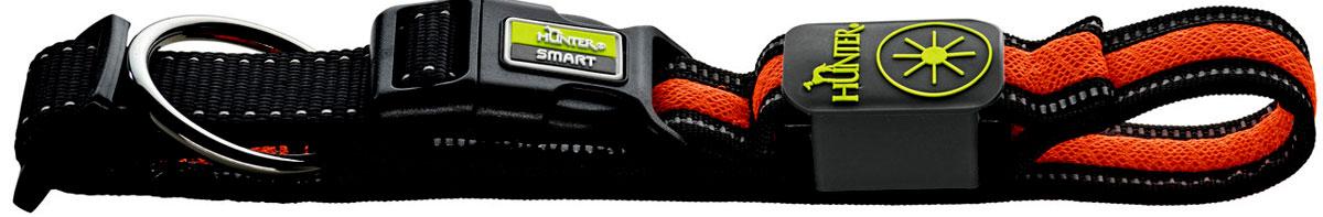 Ошейник Hunter LED Manoa Glow, cветящийся, цвет: черный, оранжевый, размер: L (55-60 см)93104Стильный светодиодный ошейник Hunter LED Manoa Glow выполнен из прочного качественного текстиля и имеет специальное кольцо для крепления к поводку. Зарядка ошейника - через USB. Дополнительные отражающие полосы улучшают видимость при выключении светодиодов. С ошейником Hunter LED Manoa Glow питомец всегда будет на виду благодаря четырехчасовому миганию или постоянному освещению. Обхват шеи 55-60 см.