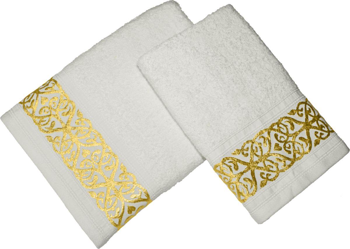 Мягкое махровое полотенце декорировано по краям тканевыми полосками тон в тон с легким благородным блеском. Отличается невероятно приятной на ощупь фактурой материала. Легко впитывает влагу и быстро высыхает.  В наборе два изделия.