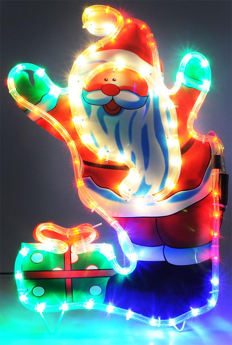 """Светодиодная фигура """"Дед Мороз с подарком"""" сделана из цветного пластика, окаймленного прозрачным светодиодным шнуром с разноцветными светодиодами (84 LED). На легком металлическом каркасе с обратной стороны фигуры предусмотрена откидывающаяся подставка для устойчивой установки фигуры на земле.  Применяется как внутри, так и снаружи помещений.  Длина сетевого шнура: 3 м.  Размер: 37 х 56 см."""