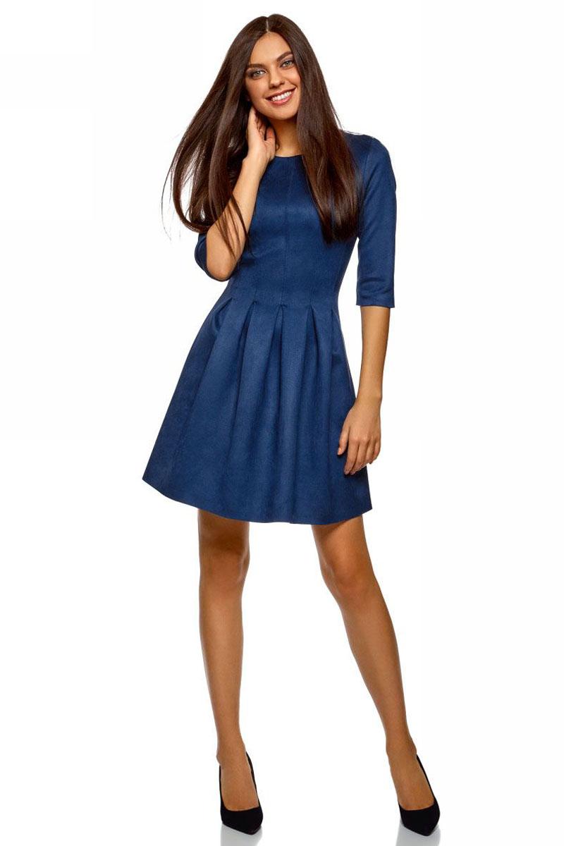 Платье oodji Ultra, цвет: темно-синий. 18L00007/47301/7900N. Размер 38 (44-170)18L00007/47301/7900NСтильное платье oodji Ultra выполнено из искусственной замши. Модель имеет расклешенный низ, круглый вырез горловины и рукава 1/2. Модель застегивается на спинке на крючок.