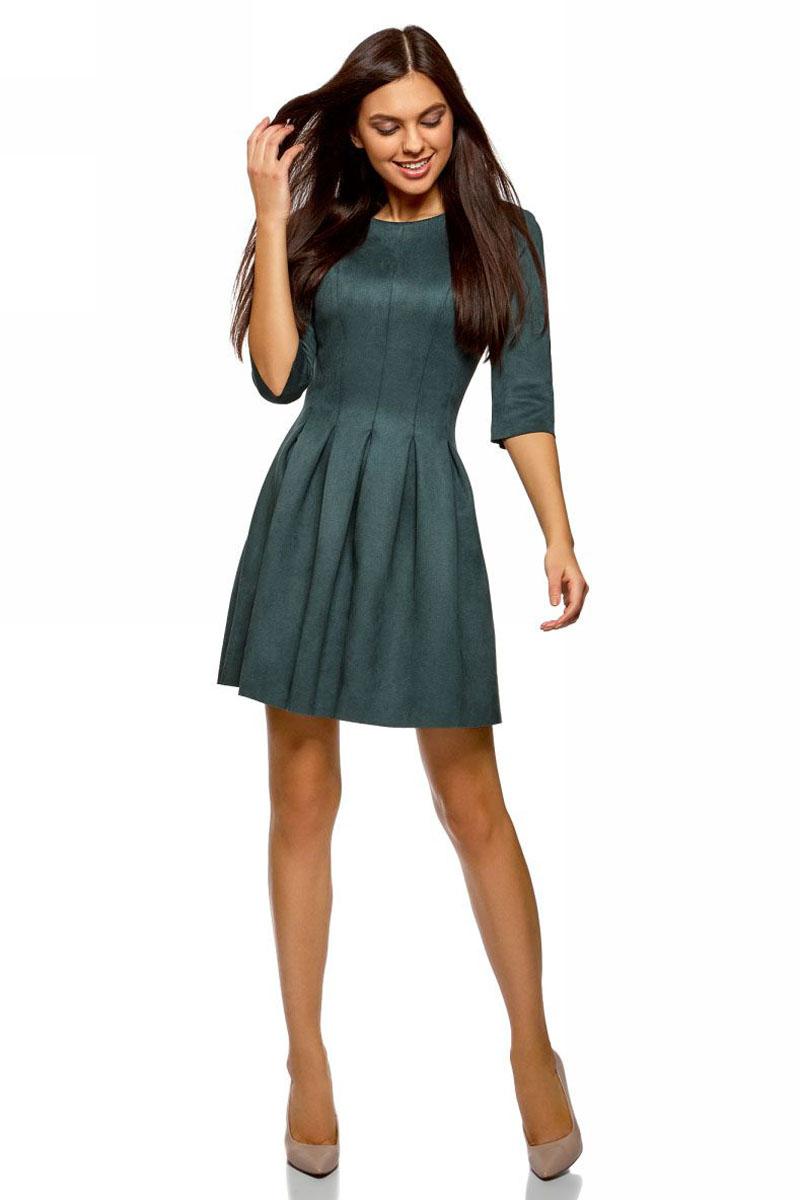 Платье oodji Ultra, цвет: морская волна. 18L00007/47301/6C00N. Размер 36 (42-170)18L00007/47301/6C00NСтильное платье oodji Ultra выполнено из искусственной замши. Модель имеет расклешенный низ, круглый вырез горловины и рукава 1/2. Модель застегивается на спинке на крючок.