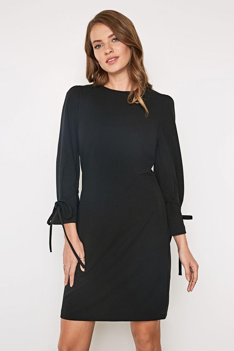 Платье Concept Club Clover, цвет: черный. 10200200415_100. Размер L (48)10200200415_100Платье из плотной эластичной ткани. Модель с круглым вырезом горловины и оригинальными рукавами длиной 7/8. На спинке платье дополнено застежкой-молнией.