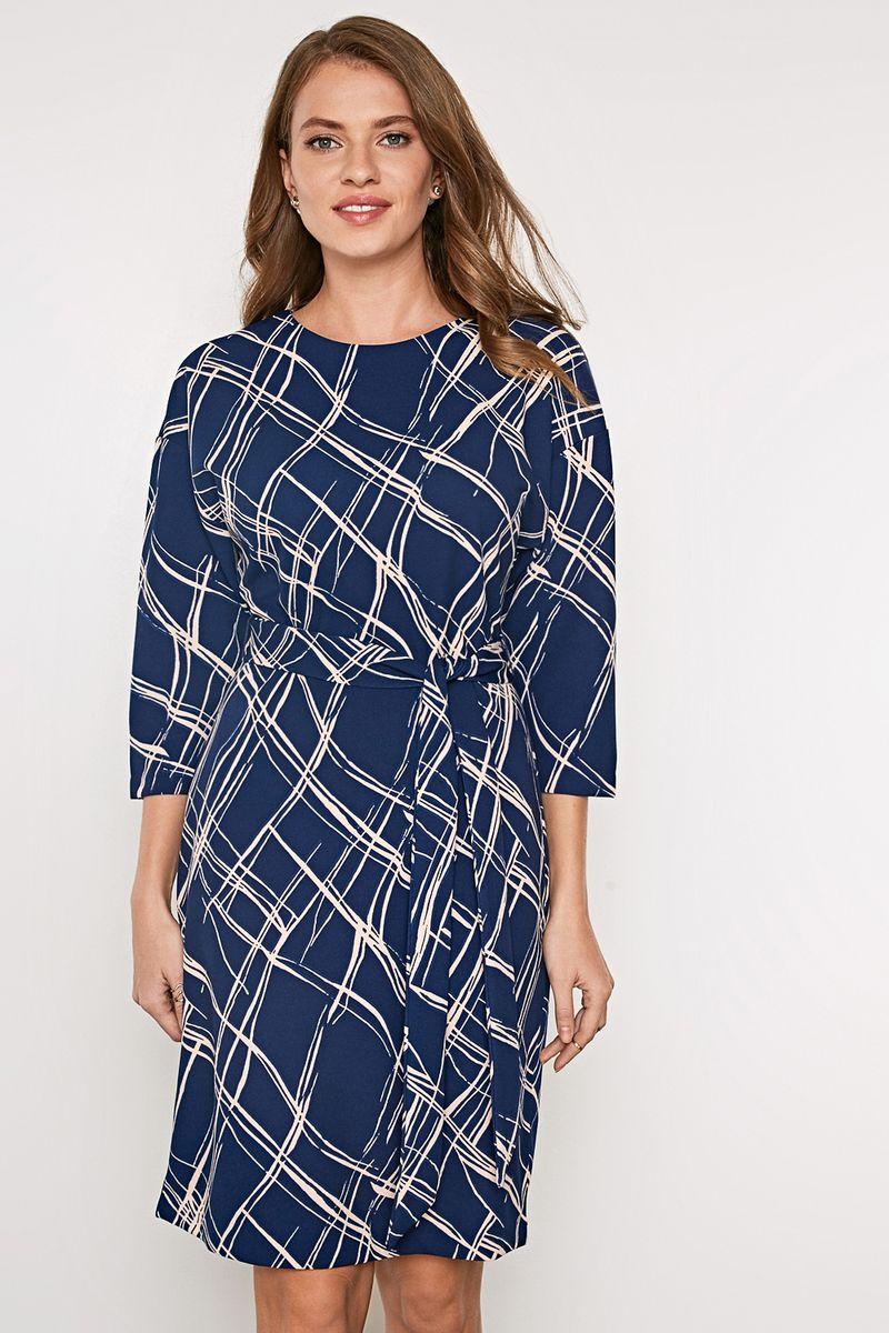 Платье Concept Club Bally, цвет: темно-синий. 10200200411_600. Размер S (44)10200200411_600Платье из плотной эластичной ткани с оригинальным набивным принтом. Приталенный силуэт со съемным поясом на талии. Модель с круглым вырезом горловины и рукавами 3/4 с заниженной линией плеча. На спинке платье застегивается на молнию и дополнено шлицей.