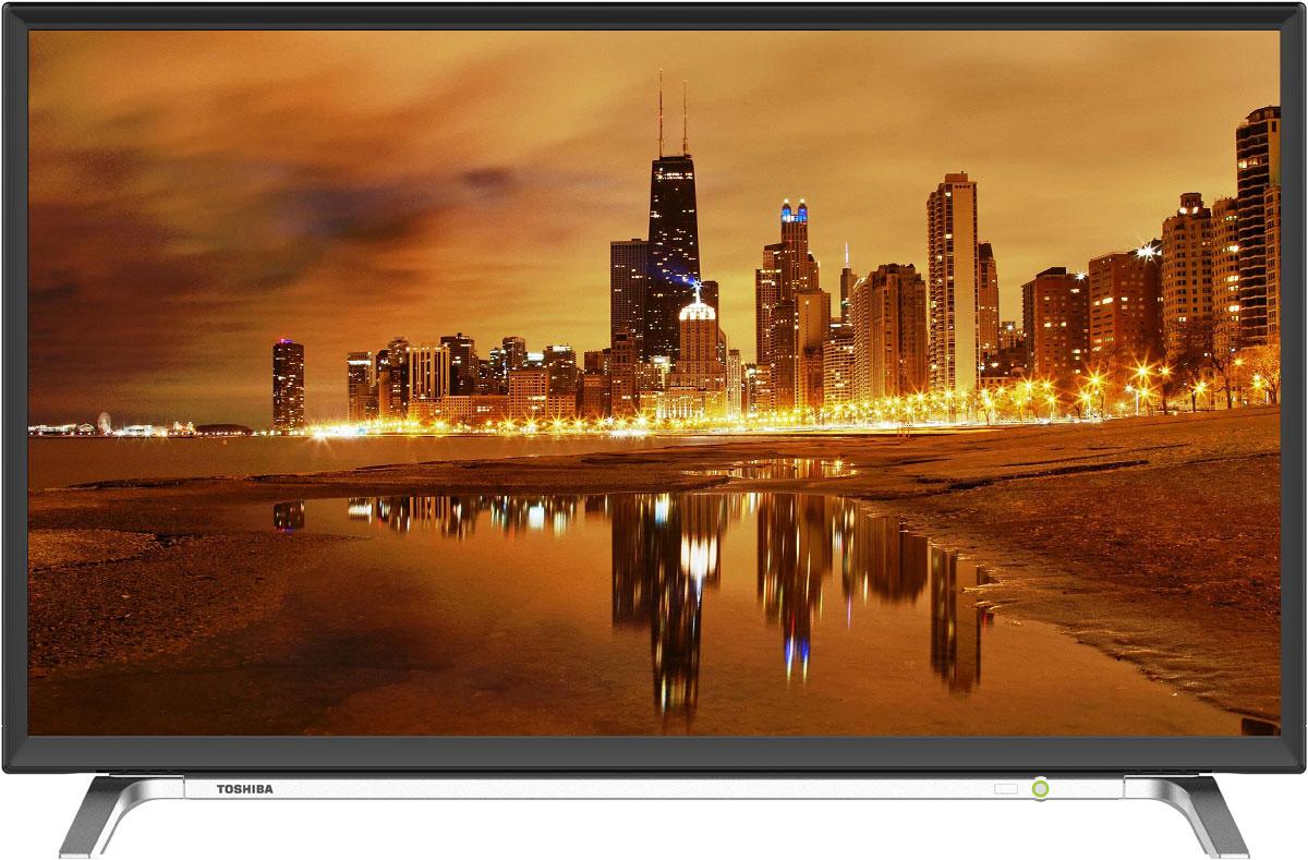 Toshiba 32L0VN телевизор32L0VN32-дюймовый HD телевизор Toshiba 32L0VN является идеальным решением для многих видов развлечений - независимо от того, хотите вы насладиться телевизионным вещанием или воспроизводить контент с USB-накопителя и жесткого диска. Этот телевизор прекрасно справится в любой ситуации.Подключите и играйтеБывает время, когда нет ничего чтобы вы хотели посмотреть. Почему бы не посмотреть на таком экране свои собственные медиафайлы?! Toshiba 32L0VNпозволяет воспроизводить музыку, фотографии и видео, с устройства хранения USB-флешки. 32L0VN также включает в себя два порта HDMI для подключения широкого спектра мультимедийных устройств для воспроизведения медифайлов или игровой деятельности.LED ТВПодсветка LED улучшает показатели динамического контраста и яркости ЖК панели что позволяет улучшить передачу черного и белого цветов.HDMIСовременный мультимедийный интерфейс HDMI для передачи несжатого потока аудио и видео данных. По одному кабелю возможна передача несжатого цифрового видео и многоканального звука со скоростью намного выше, чем позволяли все предыдущие варианты подключения. Одиночный кабель значительно упрощает процесс установки домашних развлекательных систем и гарантирует наилучшее качество изображения и воспроизведения звука.