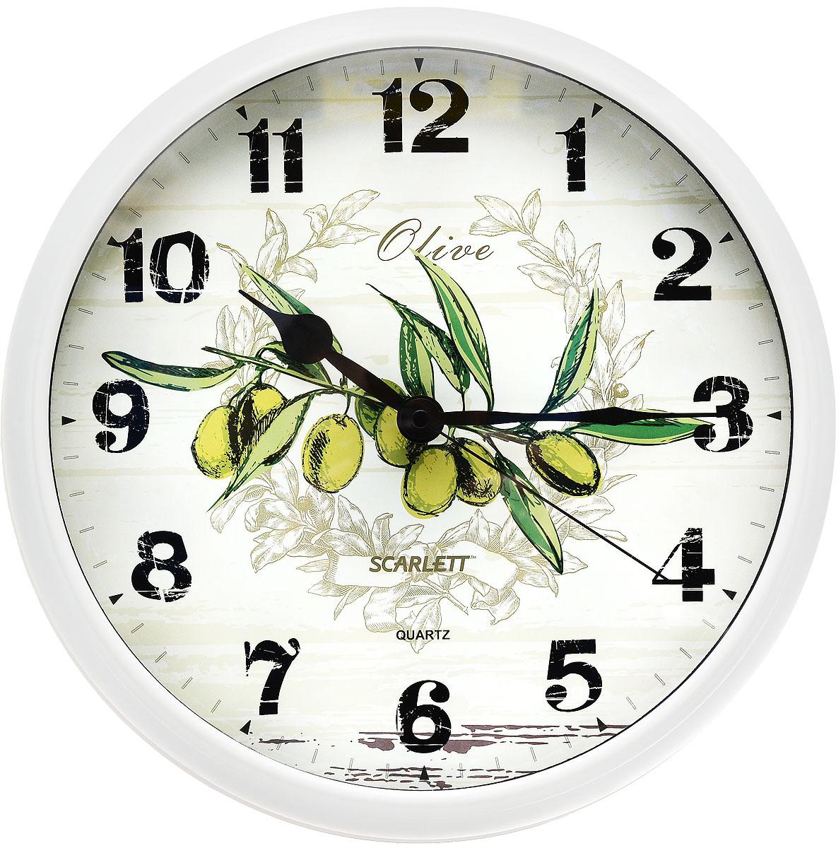 """Настенные кварцевые часы """"Scarlett"""" в классическом дизайне,  изготовленные из пластика, прекрасно впишутся в интерьер  вашей кухни. Круглые часы имеют три стрелки: часовую,  минутную и секундную, циферблат защищен прозрачным  пластиком.  Часы работают от 1 батарейки типа АА напряжением 1,5 В  (батарейка в комплект не входит).   Диаметр часов: 31 см."""