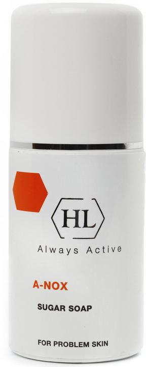 Holy Land Сахарное мыло A-Nox Sugar Soap, 125 мл102034Специальное безмыльное мыло для жирной и проблемной кожи. Содержит высокие концентрации натуральных антисептических компонентов: сахарозы и лимонного сока, которые обуславливают его специфическое действие.Действие:Тщательное очищение и обезжиривание кожи при высоком уровне антисептики.Создание на поверхности кожи кислой среды, препятствующей размножению сапрофитной и условно-патогенной флоры.Нормализация секреции сальных желез и уменьшение жирного блеска.Подсушивание поверхностных пустул.Сокращение пор.Заживление ран и воспалений.Мягкое осветление рубцов.Активные компоненты: Сахароза, содержащаяся в высокой концентрации, образует на коже антисептический слой, подсушивает, сокращает поры.Лимонный сок содержит лимонную и аскорбиновую кислоты, а также соли калия, кальция, магния, фосфора и серы. Ускоряет процесс отшелушивания клеток рогового слоя и обновления эпидермиса, восстанавливает поврежденную кожу, активизирует микроциркуляцию. Создает на поверхности кожи кислую среду, которая препятствует размножению бактерий. Регулирует pH кожи, оказывает антисептическое и противовоспалительное действие. Контролирует салоотделение, осветляет комедоны, стягивает поры, отбеливает кожу. Повышает тонус усталой кожи, улучшает цвет лица.