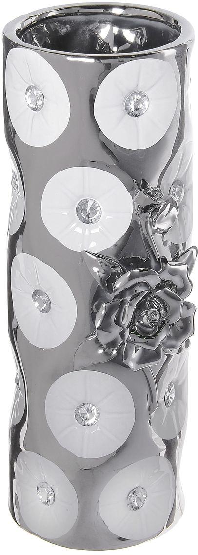 Ваза Sima-land Цветочное сопрано, высота 25 см866191Ваза Sima-land Цветочное сопрано, изготовленная из высококачественной керамики, декорирована стразами. Интересная форма и необычное оформление сделают эту вазу замечательным украшением интерьера. Она предназначена как для живых, так и для искусственных цветов. На основании изделия имеются противоскользящие накладки. Любое помещение выглядит незавершенным без правильно расположенных предметовинтерьера. Они помогают создать уют, расставить акценты, подчеркнуть достоинства или скрытьнедостатки.