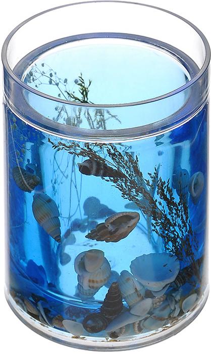 """Стакан """"Лагуна"""", изготовленный из прозрачного пластика, отлично подойдет для вашей ванной комнаты. Внутри стакана синий гелиевый наполнитель с морской звездой, ракушками и веточками. Стакан создаст особую атмосферу уюта и максимального комфорта в ванной. Характеристики:   Материал: пластик, акрил, гелиевый наполнитель. Цвет: синий, белый, черный. Диаметр стакана по верхнему краю: 7 см. Высота стакана: 10,5 см. Производитель: Швеция. Изготовитель: Китай. Размер упаковки: 8,5 см х 8,5 см х 12,5 см. Артикул: 336-01."""