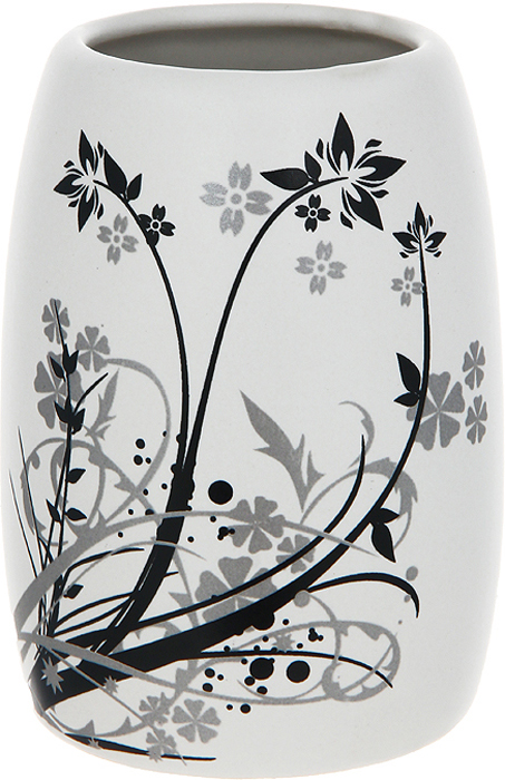 """Стаканчик Duschy """"Aster"""" выполнен из керамики молочного цвета, украшен растительным рисунком черного и серого цвета. Стаканчик отличается легкостью и компактностью, при этом он устойчив. Такой стаканчик прекрасно подойдет для зубных щеток, пасты, расчесок и станет достойным дополнением интерьера ванной комнаты. Характеристики:Материал: керамика. Цвет: молочный. Размер стаканчика: 10 см х 7 см х 7 см. Размер упаковки: 11,5 см х 8,5 см х 8,5 см. Артикул: 354-01."""