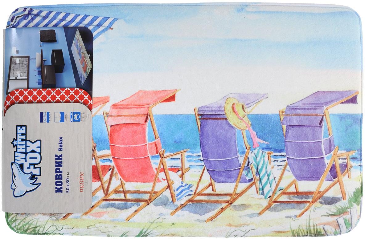 """Коврик White Fox """"Пляж"""" из серии Relax равномерно распределяет нагрузку на поверхность стопы, снимая напряжение и усталость в ногах. Он состоит из трех слоев: - верхний флисовый слой прекрасно """"дышит"""", благодаря чему коврик быстро высыхает;- основной слой выполнен из специального вспененного материала, который точно повторяет рельеф стопы, создает комфорт и полностью восстанавливает первоначальную форму;- нижний резиновый слой препятствуют скольжению коврика на полу. Качественное изделие притягивает взгляд и прекрасно подойдет к интерьеру вашего дома.Можно стирать в стиральной машине при температуре 30°С.   Размер: 50 см х 80 см."""