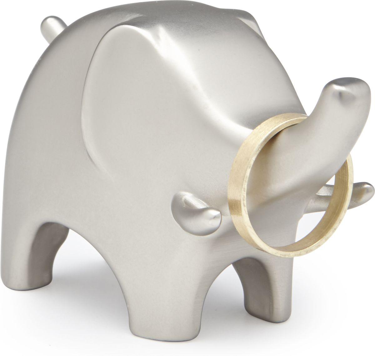 Подставка для колец Umbra Anigram. Слон, цвет: никель299114-410Подставка для колец Слон от Umbra прекрасно подойдет как любительницам порядка, так и просто высоко эстетичным натурам. Она станет незаменимым помощником на прикроватной тумбочке или в ванной комнате, там, где приходится расставаться с любимыми украшениями во имя бережного к ним отношения. Сочетание металла прорезиненного покрытия делает использование подставки приятным и удобным. Стоит отметить самое главное -такая милая вещица точно украсит любой интерьер!