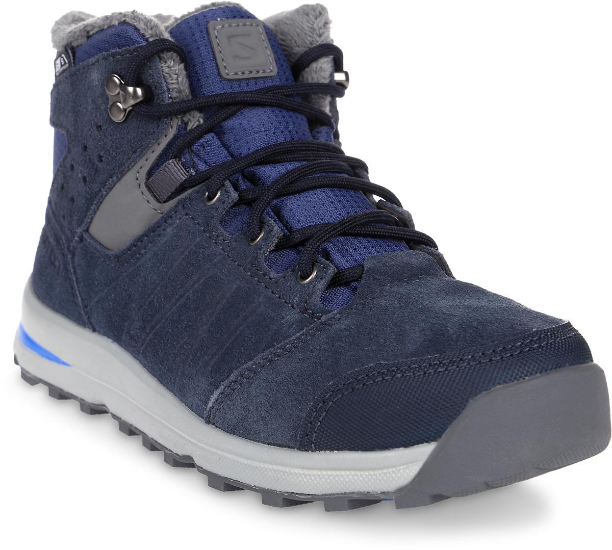 Ботинки для мальчика Salomon Utility TS CSWP J, цвет: синий. L39186900. Размер 32 (30,5)L39186900Утепленные ботинки выполнены из непромокаемого текстиля и натуральной кожи. Классическая шнуровка надежно фиксирует модель на ноге. Мысок усилен вставкой из искусственного материала. Подошва оснащена рифлением для лучшего сцепления с любой поверхностью.