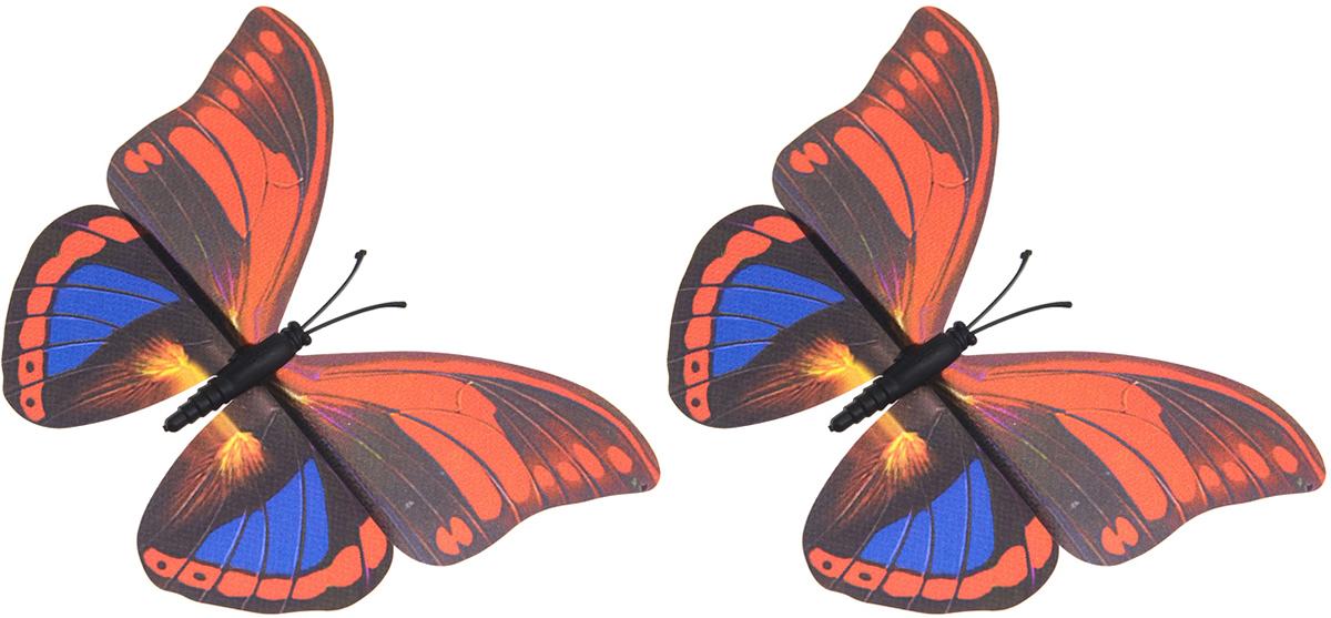 """Декоративная фигурка Village People """"Тропическая бабочка"""" изготовлена из ПВХ. Изделие выполнено в виде бабочки и оснащено магнитом, с помощью которого вы сможете поместить изделие в любом удобном для вас месте. Это не только красивое украшение, но и замечательный способ отпугнуть птиц с грядок. Яркий дизайн фигурки оживит ландшафт сада.Уважаемые клиенты!Обращаем ваше внимание на возможные изменения в цветовом дизайне, связанные с ассортиментом продукции. Поставка осуществляется в зависимости от наличия на складе."""