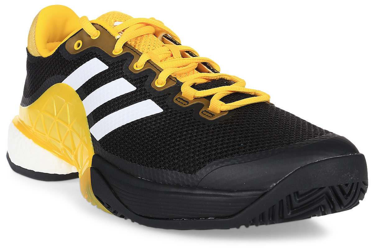 Кроссовки для тенниса мужские Adidas Barricade 2017 Boos, цвет: черный, желтый, белый. CG3087. Размер 10 (43)CG3087Контролируйте ход игры и побеждайте в каждом сете. Мужские теннисные кроссовки Adidas Barricade 2017 Boos с амортизацией boost возвращают энергию каждого шага и обеспечивают устойчивость на любой поверхности даже на высоких скоростях.Бесшовный вязаный верх плотно обхватывает ногу, обеспечивая надежную посадку. Вязаный верх естественным образом растягивается, адаптируясь под форму стопы, и ,таким образом, снижает риск раздражения кожи и обеспечивает комфортную посадку; бесшовная конструкция подкладки плотно облегает стопу для комфортной посадки. Износостойкая вставка ADITUFF в передней и средней части кроссовка защищает стопу от пробуксовки и подворачивания во время подач, ударов с лета и резких боковых движений. Гибкий мысок позволяет пальцам двигаться естественно. Каркас BARRICADE поддерживает и стабилизирует среднюю часть стопы во время динамичных маневров на корте. Анатомическая конструкция GEOFIT для комфорта; слегка расширенная передняя часть. Исключительно износостойкая подошва ADIWEAR.
